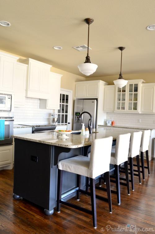 Huge Black Island in White Kitchen