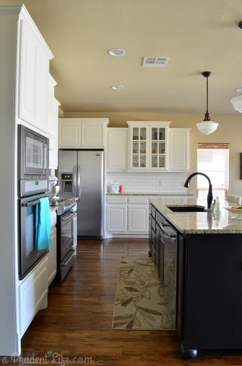 White Kitchen Black Island Wood Floor