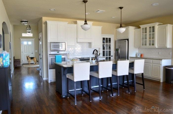 Wide view of white kitchen
