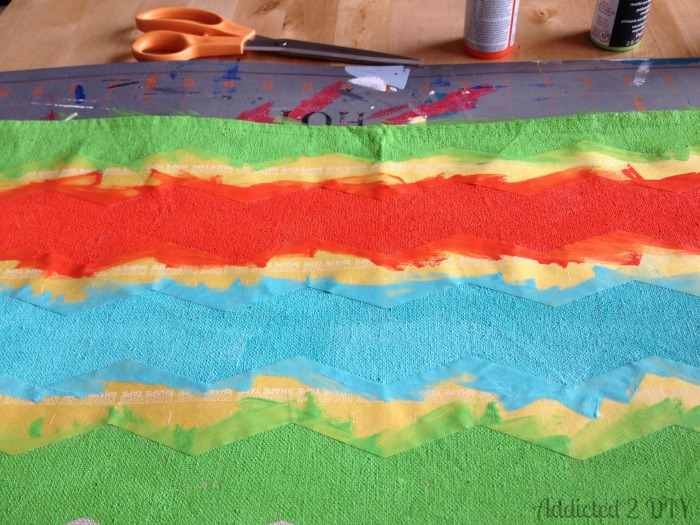 Make drop clothes into placemats with tape & paint
