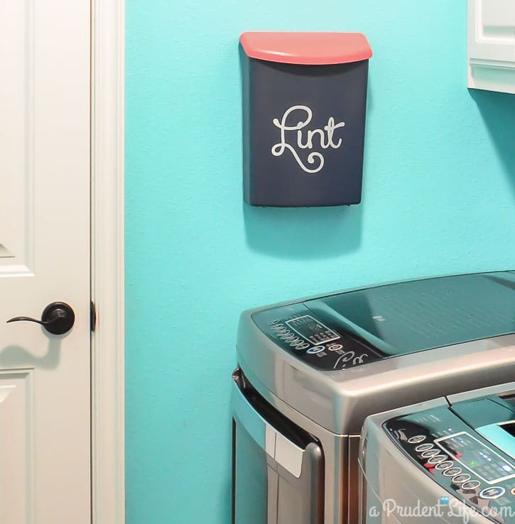 Wall mounted bin for lint in laundry room