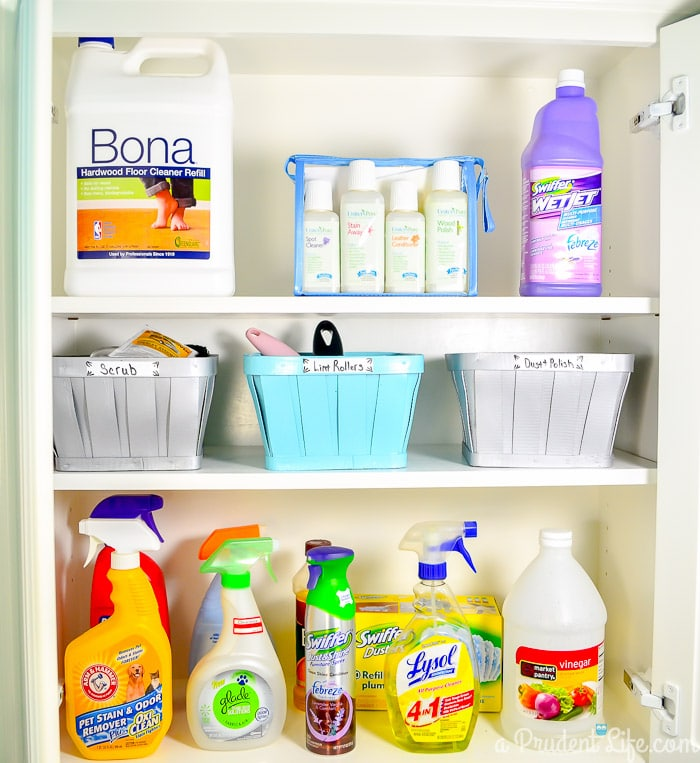 Organized laundry cabinet - click to see the full room!