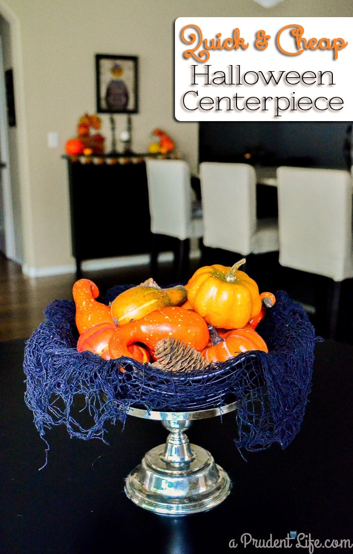 Turn a thrift store candle stick & dollar store materials into a cute Halloween centerpiece in under a minute!