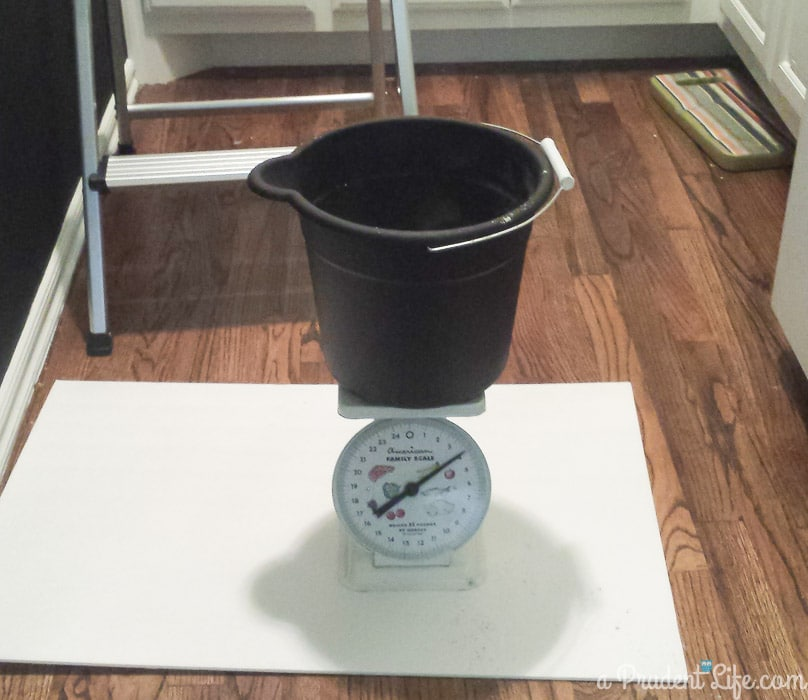 Kitchen scale used to weigh grout mixture