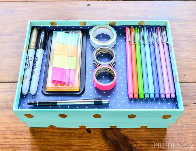 Consider using a box lid for desk top organization