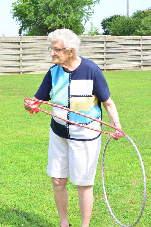 Gram playing hula hoop toss at her birthday party/Tournament of Champions