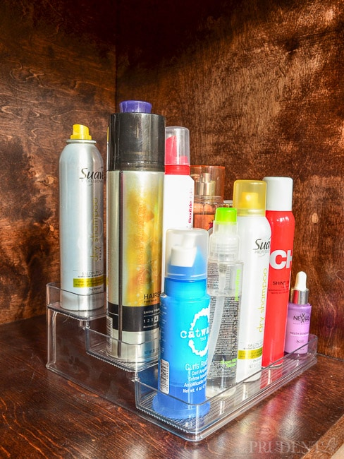 Great idea! Organize hair products under the sink on a tiered organizer.