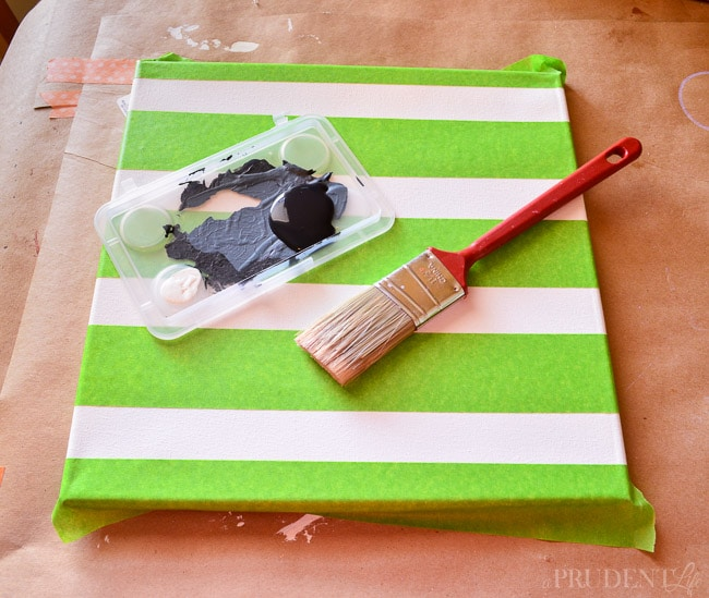 Use Frog Tape to paint stripes on a canvas