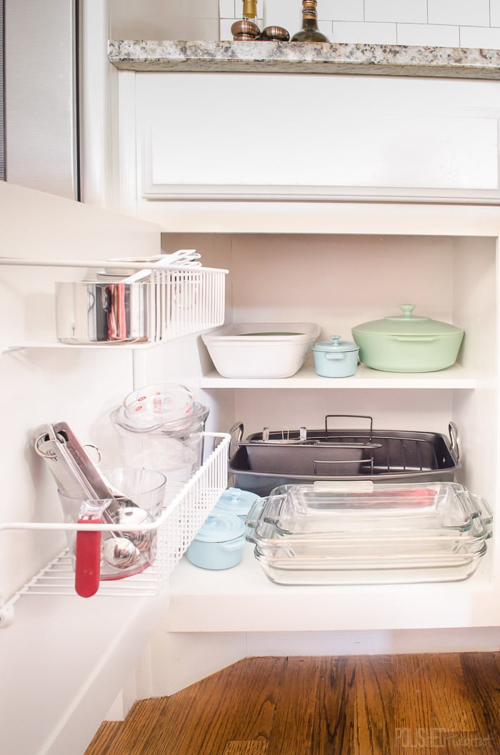 Don't overlook cabinet doors when organizing a kitchen. Inexpensive wire shelves are great for bulky kitchen accessories like KitchenAid mixer attachments! See more kitchen organizing at PolishedHabitat.com