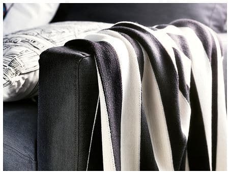 This IKEA Eivor blanket is nice and thin for chic summer styling