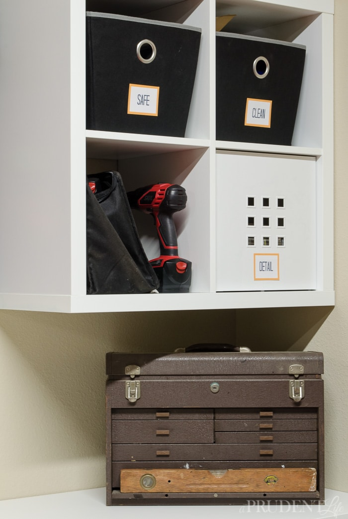 Blending new IKEA KALLAX shelving units with a vintage toolbox creates stylish, but functional garage storage.