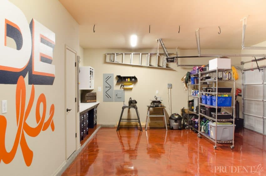 "Our garage used to be a cluttered mess, but after a makeover we have plenty of room to create. Dividing the space into a workshop and ""shed"" was easy using $99 rolling shelving units."