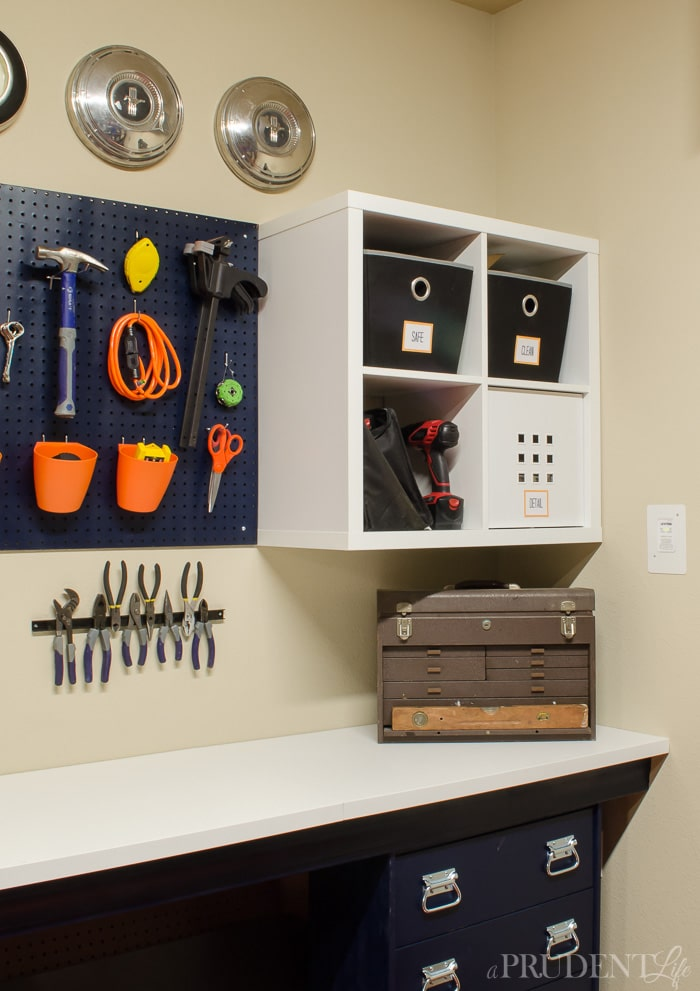 Adding pegboard and magnetic strips to the garage wall makes it easy to store tools in plain site. Perfect for a fun garage makeover.
