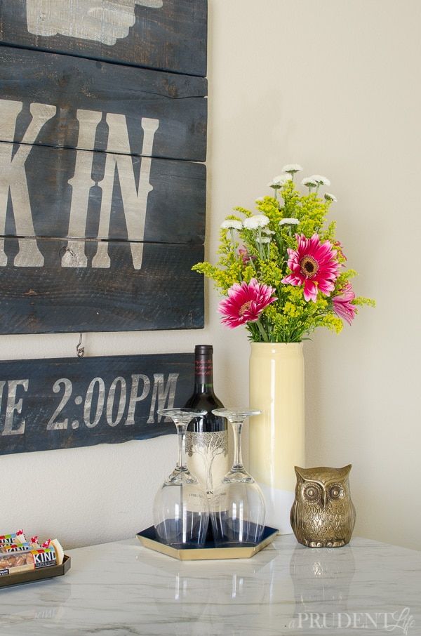 Spoil your house guests with fresh flowers and a bottle of wine!