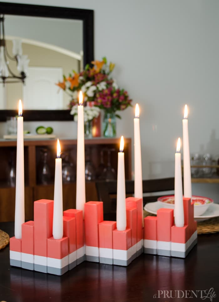 Adding summer color to your dining room is inexpensive with this DIY candle centerpiece. I created my centerpiece with $2 worth of wood and some spray paint!