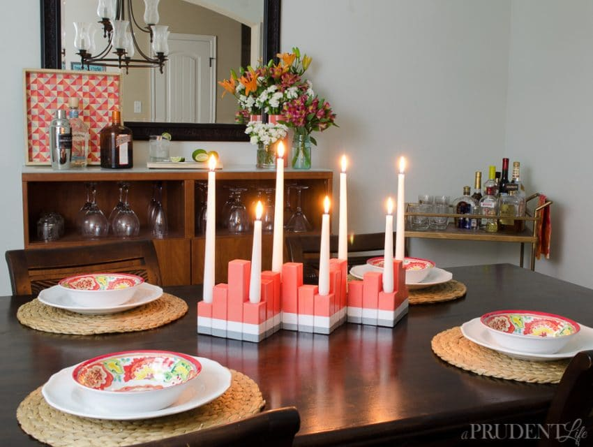 Update your dining room for summer with a few inexpensive items. My DIY centerpiece only cost $2 plus paint! Full tutorial included.