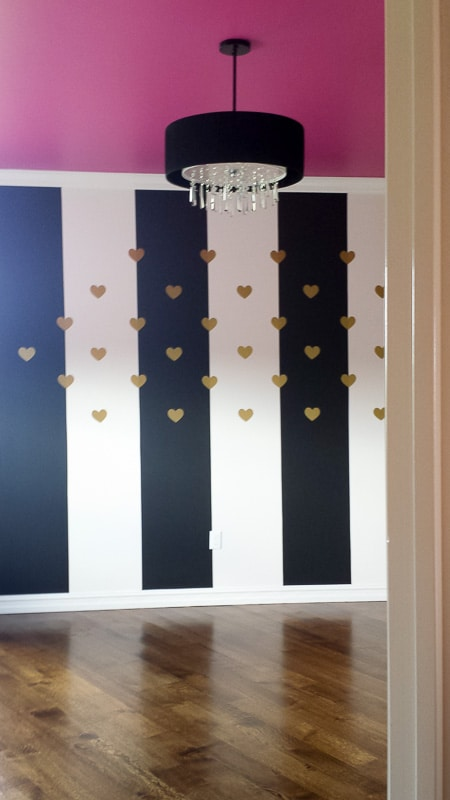 What a fun design idea for a girls room - black and white stripes with a pink ceiling!