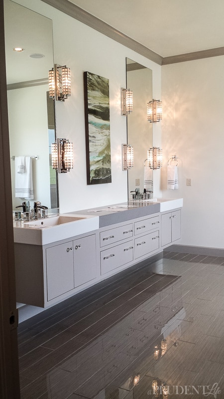 The floating vanity and high gloss floor in the modern bathroom are divine.