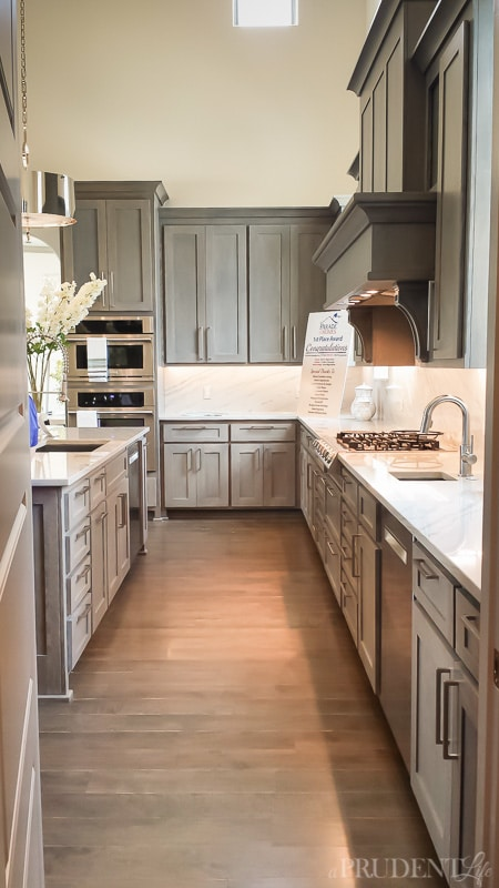 Gray kitchen cabinets are a perfect compliment to marble countertops.