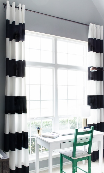 Black and white striped curtains add chic style to any room. Check out these tips for making them yourself (WITHOUT sewing!)