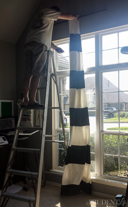 Spray paint has SO many uses - including creating gorgeous black and white striped curtains!