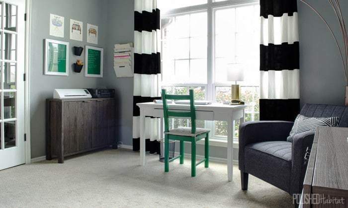 Black and white curtains make a bold statement in this chic home office. Emerald green pops against all the neutrals - click for a full tour and the before photos!
