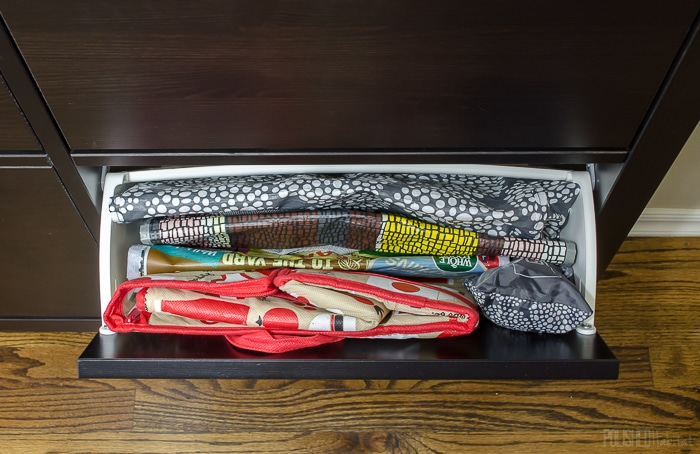Use an IKEA shoe cabinet to add kitchen storage. One of the 14 ideas in this post is to use one drawer for reuseable grocery bags. Click to see the other 13 ideas!