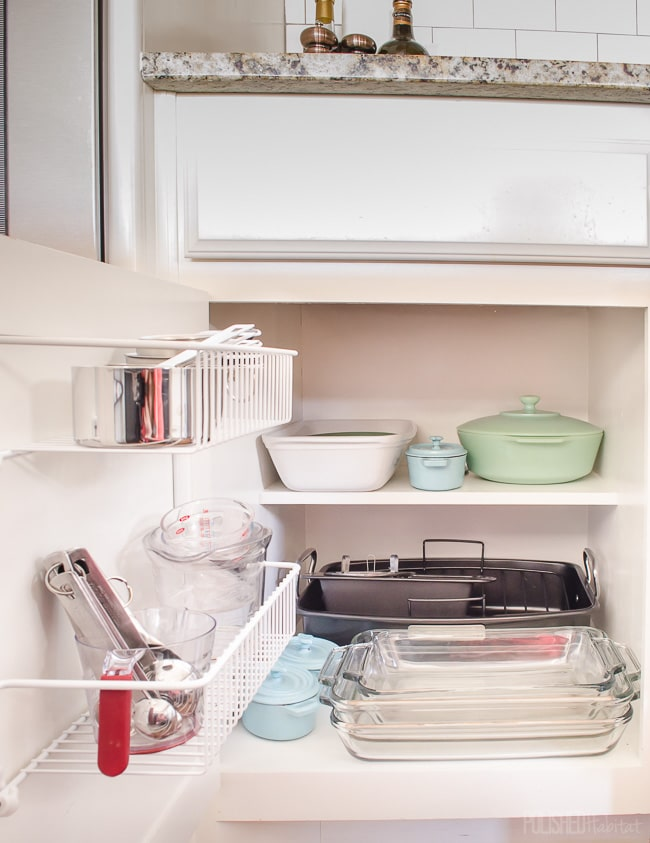 Don't overlook cabinet doors when organizing a kitchen. Inexpensive wire shelves are great for measuring cups and spoons! See more kitchen organizing at PolishedHabitat.com