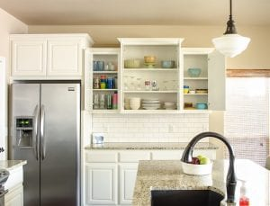 Kitchen a mess? This post shows how I organized everything from spices to Rubbermaid containers in our kitchen cabinets. Links to organization solutions for the under the kitchen sink, in the pantry, and in the refrigerator are also included!