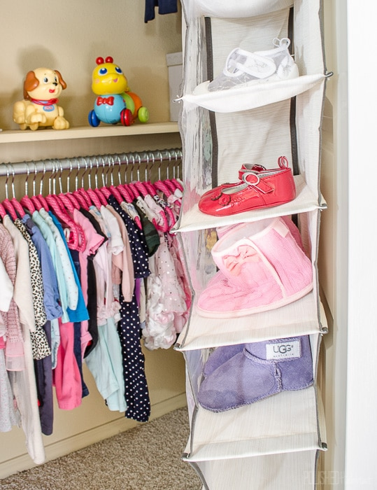 Add storage to a baby's closet with an inexpensive shoe organizer. Click for more ideas that will grow right along with baby.