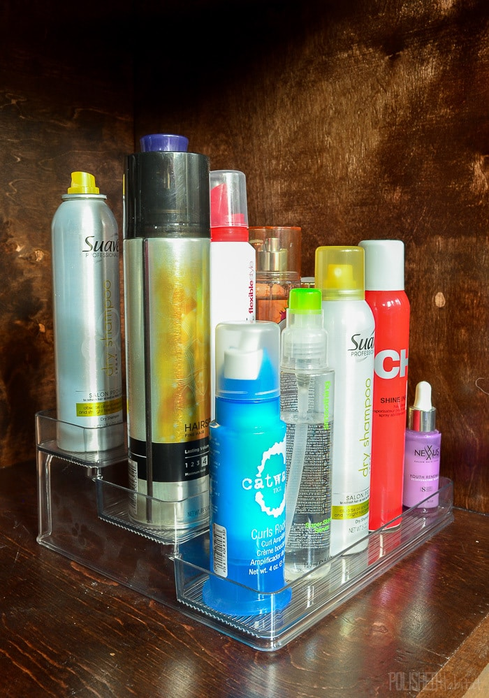 No more bathroom clutter! Move hair products under the sink to keep the bathroom vanity organized.