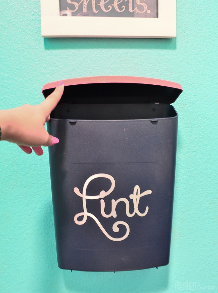 This Lint Bin is wall-mounted to save floor space. It's great for keeping the laundry room neat!
