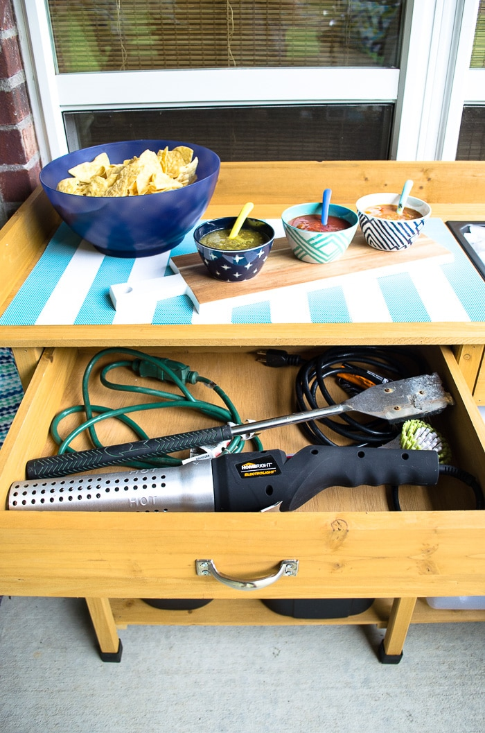 Get the patio organized AND add serving space with this affordable potting bench. It works as the perfect bar and has both drawer and shelf space. Love it!