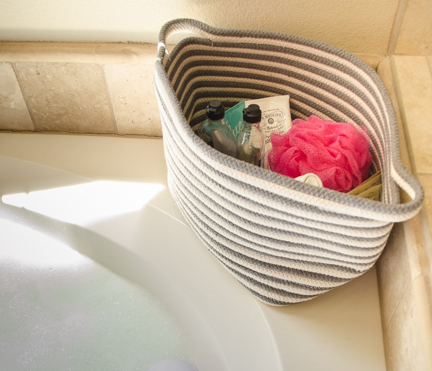 Use a basket to keep bubble bath, razors, and shaving cream out of sight but easy to access!