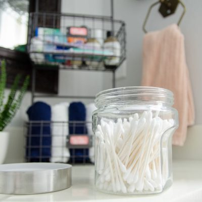 Inexpensive containers from Hobby Lobby make bathroom organization easy AND chic!