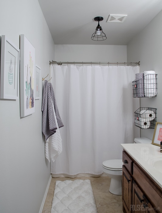 Budget Bathroom Refresh - This guest bathroom went from boring beige to organized modern industrial style in one weekend for under $300.