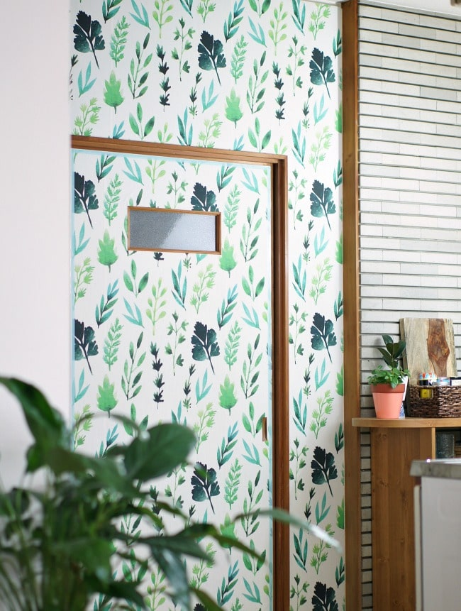 cover ugly rental walls with renter friendly removable wallpaper