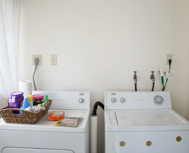 hide cords and hoses in the laundry room with this easy DIY