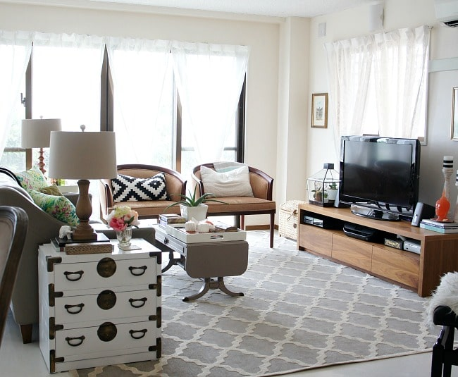 hide cords under rugs and furniture