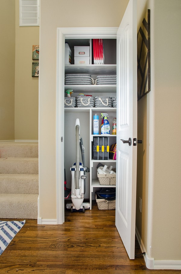 Organized cleaning closet with space for vacuum and other supplies