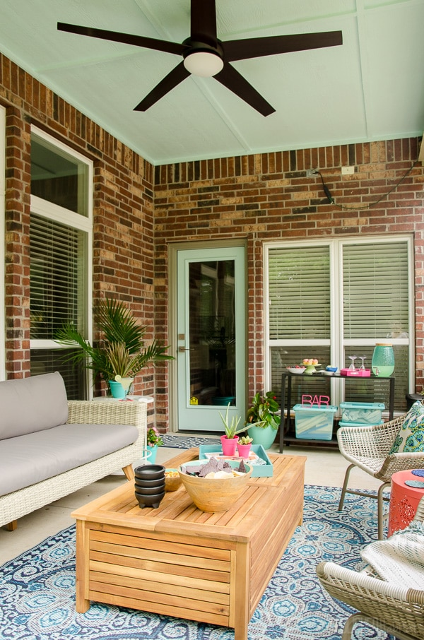 Patio Makeover! This porch went from dreary to a perfect relaxing spot for reading or entertaining. The furniture was provided by Cost Plus World Market. Click for before and more after photos! #ad