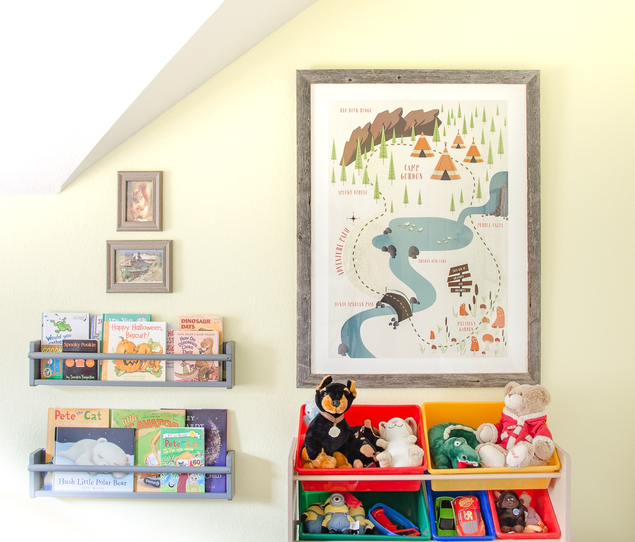 Books displayed front forward on wall racks in camping themed boy's room