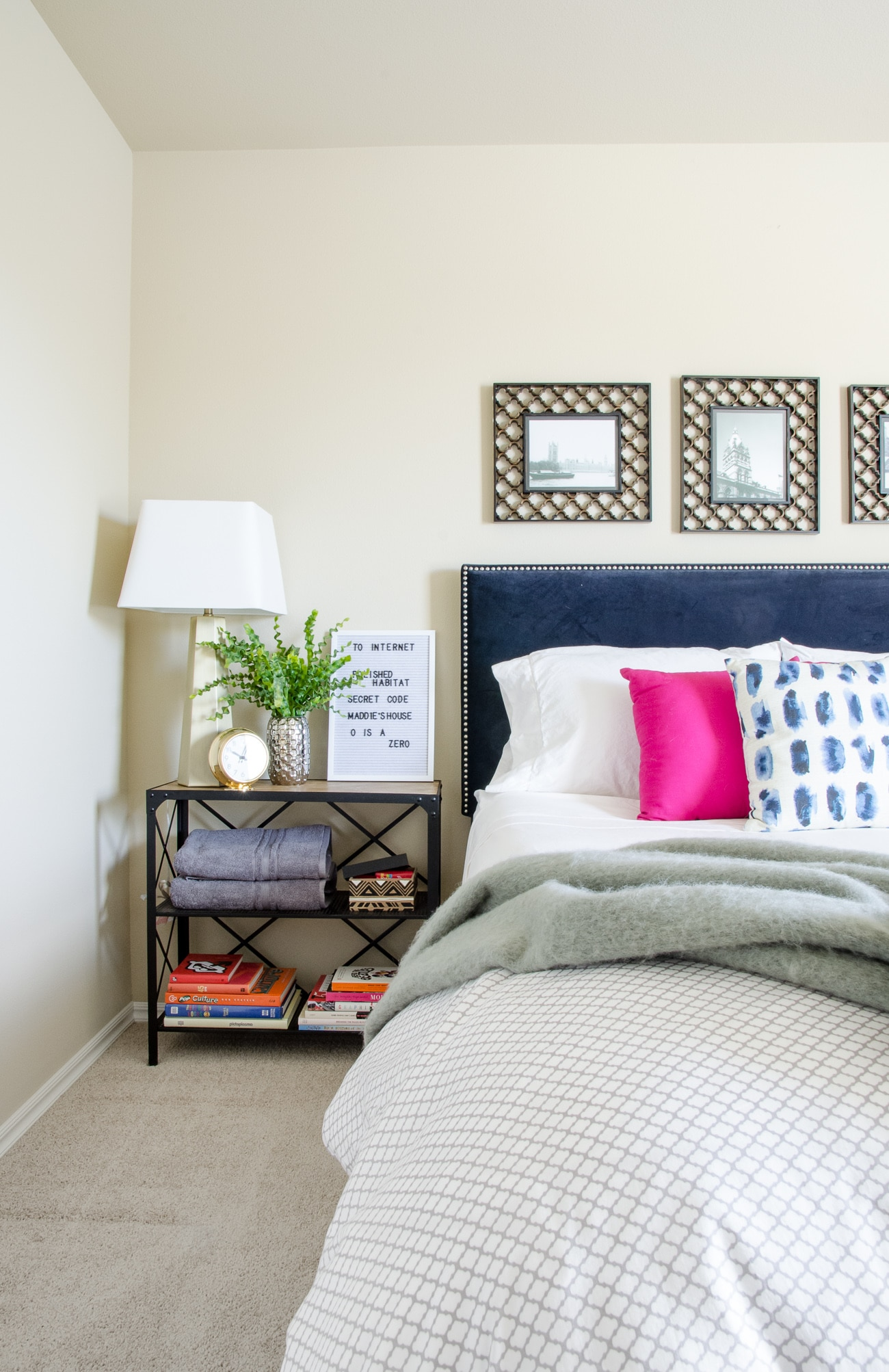 Guest bedroom with bookshelf that doubles as a nighstand