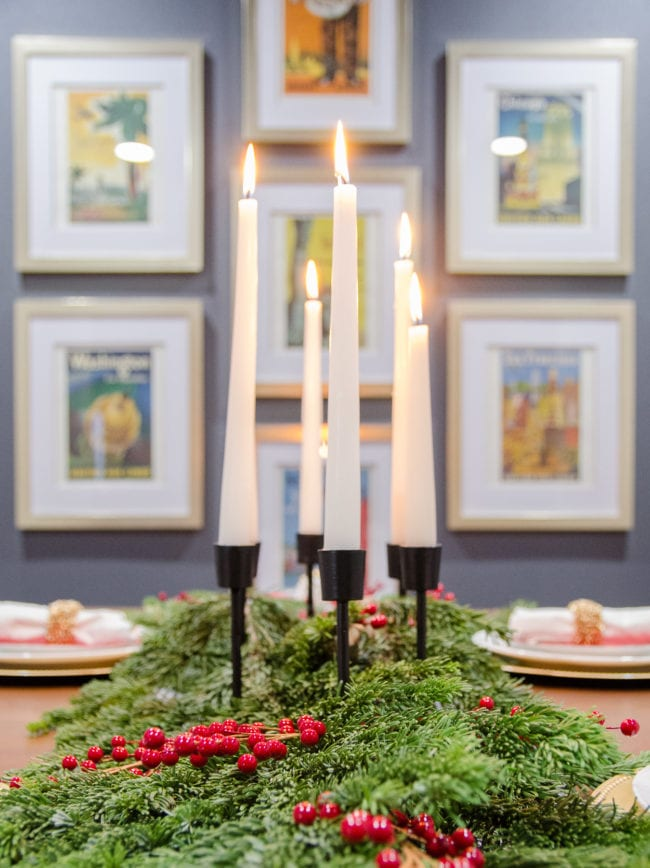Threshold modern black candlestick with fresh greenery as a table runner for Christmas