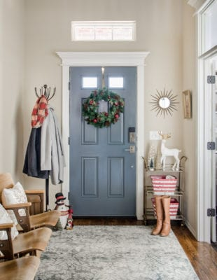 Entryway with gray door and vintage seating