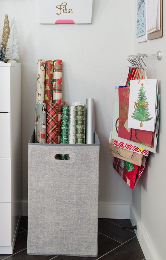 Keep wrapping paper organized with a hamper and one little trick to keep it straight.