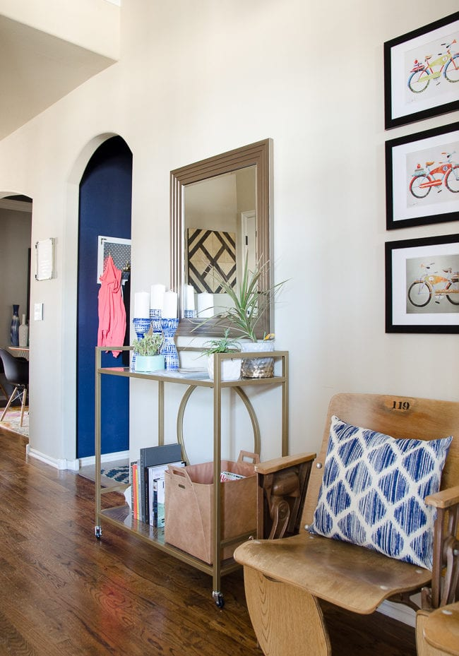 Entryway with organization for magazines and vintage theater seats.