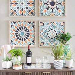 Colorful art and console styling in small kitchen nook.