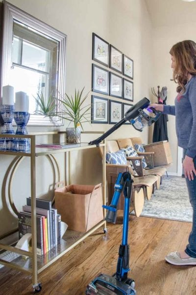 Using Shark IonFlex vacuum for dusting.