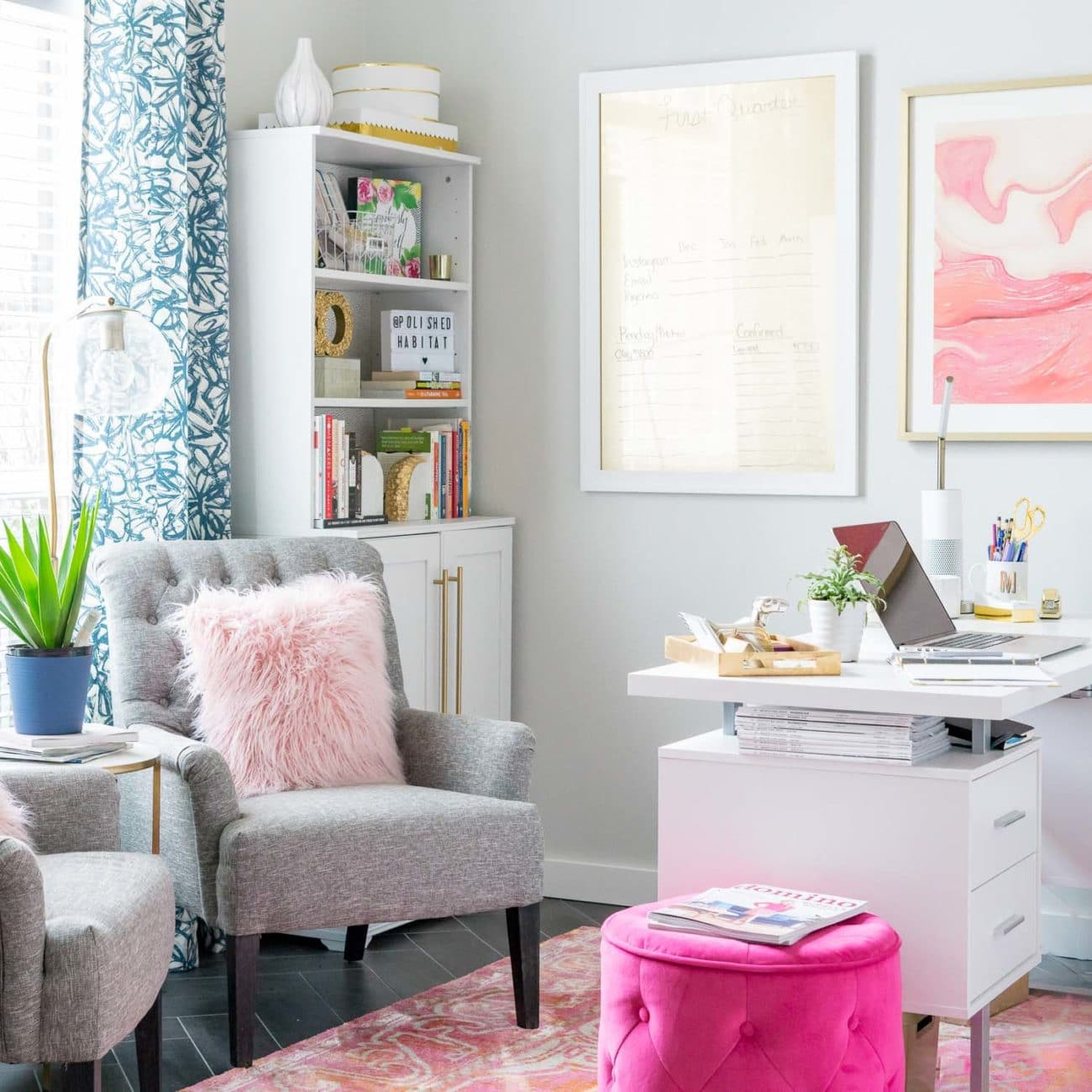 Pink, white, and gold women's office with extra seating and bookcases